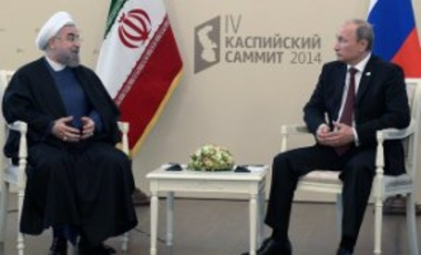 Iranian President Hassan Rouhani talks with Russian President Vladimir Putin during the Caspian Sea summit in Astrakhan, Russia, 29 September 2014