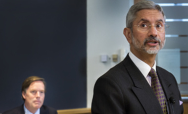 Ambassador Jaishankar speaking with Professor Nicholas Burns in the background.