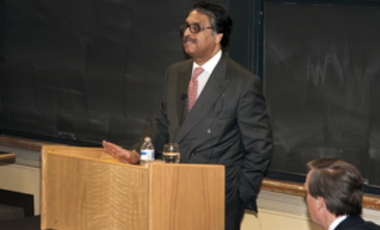 Ambassador Jilani speaking with Professor Nicholas Burns in the foreground.