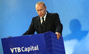 Russian Prime Minister Vladimir Putin speaks at an investment forum in Moscow, Sep. 29, 2009. He told investors that the government will reduce its role in the economy and ownership of companies over the coming years to allow for better growth.