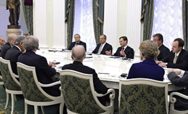 Russian President Dmitry Medvedev, center background, gestures speaking at a meeting with members of a bi-partisan commission on U.S. policy toward Russia, at the Kremlin in Moscow, Tuesday, March 10, 2009.