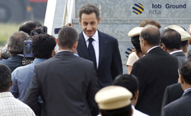 French President Nicolas Sarkozy, center, upon his arrival in Bangalore, India, Dec. 4, 2010. Sarkozy arrived on a 4-day visit to sign agreements to set up nuclear power plants in India and jointly develop satellites to study climate change.