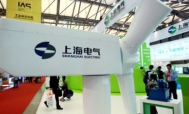 A model wind turbine at the 2011 China International Industry Fair in Shanghai, Nov. 1, 2011. Shanghai Electric Group and Siemens have announced a joint venture, which includes a wind turbine manufacturing company targeting Chinese and global markets.