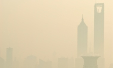 Dense air pollution and smog obscures Shanghai's skyline.