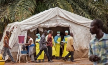 Aug. 9, 2014: health workers, center rear, screen people for Ebola virus before entering the Kenema Government Hospital in Kenema, 300 kilometers, from Freetown, Sierra Leone. Before 2014, there had been no reported cases of Ebola in West Africa.