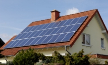 Solar panels on the roof of a single family house.