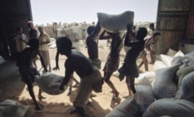 Somali port workers load food aid onto trucks from a warehouse in Mogadishu's port, Dec. 7, 1992.  Disagreements between warring warlords had kept the port closed for more than a month.