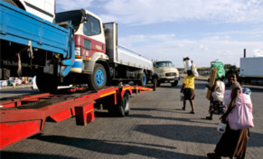 Mar. 28, 2008 file photo: trucks laden with goods headed for Zimbabwe near a border post in Musina, South Africa. South & east African states are moving toward a free trade agreement that is as much about development as open borders & dropped tariffs.