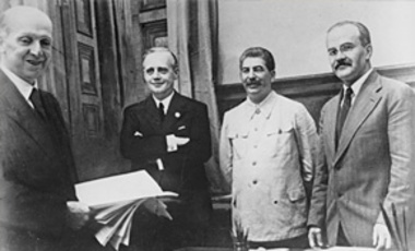(R-L) Soviet Commissar for Foreign Affairs Vyacheslav Molotov, General Secretary of the Communist Party Josef Stalin, & German Reich Foreign Minister Joachim von Ribbentrop signing the German-Soviet non-aggression pact in Moscow, Aug 23, 1939.
