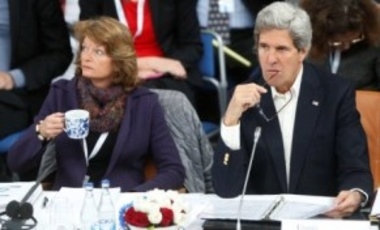 U.S. Secretary of State John Kerry, right, is seated with U.S. Sen. Lisa Murkowski, R-Alaska, during the Arctic Council Ministerial Session at City Hall in Kiruna, Sweden, May 15, 2013