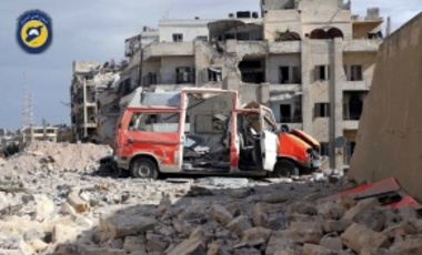 In this photo provided by the Syrian Civil Defense group known as the White Helmets, taken Sept. 23, 2016, a destroyed ambulance is seen outside the Syrian Civil Defense main center after airstrikes in the rebel-held part of eastern Aleppo, Syria.