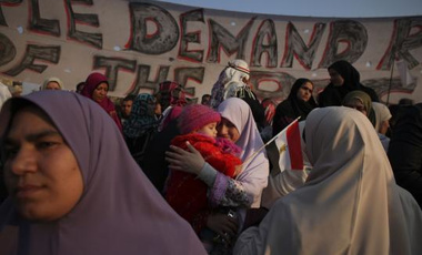 A woman hugged her daughter in Cairo's Tahrir Square yesterday, hours before Hosni Mubarak resigned as Egypt's president.