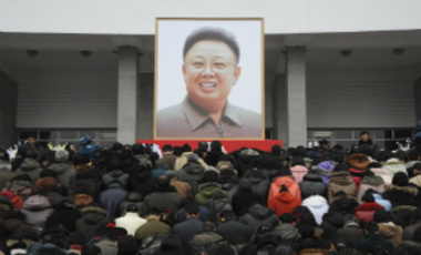 Pyongyang citizens grieve as they visit a portrait of late North Korean leader Kim Jong-il on display in the plaza of the Pyongyang Indoor Stadium in Pyongyang, North Korea, Wednesday, Dec. 21, 2011.