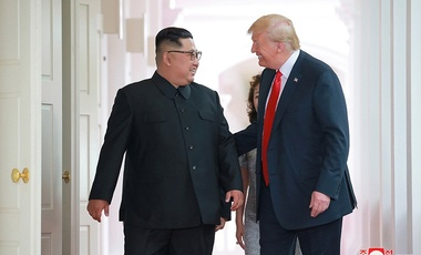 US President Donald J. Trump walked with North Korean leader Kim Jong-un at the Capella Hotel on Sentosa island in Singapore on June 12