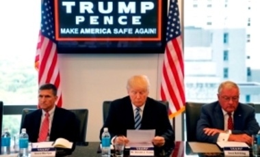 In this Aug. 17, 2016, file photo, then-Republican presidential candidate Donald Trump is in his offices in Trump Tower in NYC, with Ret. Army Gen. Mike Flynn, left, and Ret. Army Lt. Gen. Keith Kellogg, right.