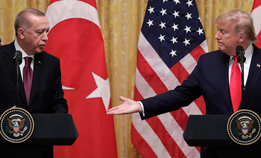 President Donald Trump gestures to Turkish President Recep Tayyip Erdogan during a news conference Wednesday, November 13, 2019.