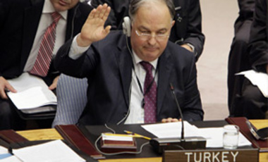 Turkey's Ambassador Ertugrul Apakan votes against sanctioning Iran during a session of the United Nations Security Council,  June 9, 2010.