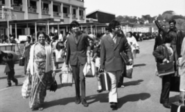 British Asians, who are among 60,000 Asians expelled from Uganda by President Idi Amin, prepare to leave Entebbe for London, Aug. 25, 1972. These expulsions coincided with Amin's demand that the UK halt a planned drawdown of military assistance to Uganda.