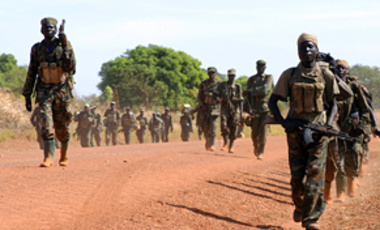 Ugandan soldiers march in the northern Pader district. The troops were deployed for operations against rebels who mutilate civilians and abduct children in the course of Africa's longest-running civil war.