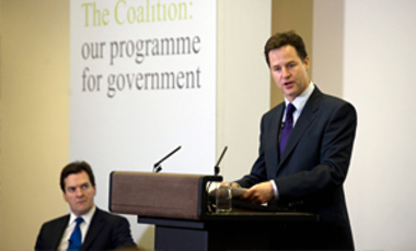 UK's Deputy Prime Minister Nick Clegg listens, as Prime Minister David Cameron speaks, during the launch of the Government Programme Coalition Agreement document in London, May 20, 2010. No party won a clear majority to govern in the May 6 election.