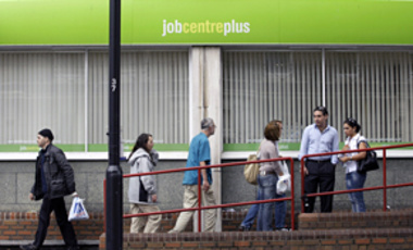 People are seen outside a job center in London, England, Sep. 16, 2009. Unemployment in Britain hit a near 13-year high in July despite signs that the deepest recession since World War II is coming to an end.