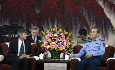 U.S. Deputy Secretary of State James Steinberg, left, and Chinese Gen. Ma Xiaotian, right, talk during a meeting in Beijing, Sep. 29, 2009. They met about North Korea amid signs Pyongyang may be willing to restart talks on its nuclear programs.