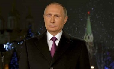 Russian President Vladimir Putin looks on as he delivers his annual New Year address to the nation in Moscow, Russia, December 31, 2015.
