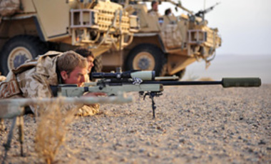 Sniper James Sudlow of 1st The Queens Dragoon Guards trains his scope on the Nawar region of Helmand province, Afghanistan, to help locate enemy forces in a fire fight between the Taliban and the Afghan National Army, Dec. 18, 2008.