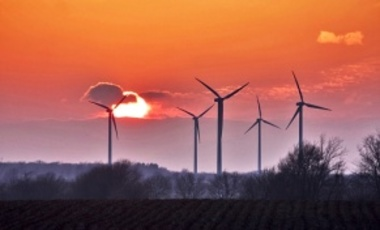 A 32-year Perspective on the Origin of Wind Energy in a Warming Climate