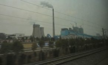 A coal-fired power plant a few miles norh of Xuzhou, seen from the Beijing-Shanghai railway, January 26, 2011. Since 2000, large-scale investments have been made in energy-intensive industries such as coal-fired electricity generation.