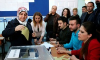 A Turkish woman casts her ballot at a polling station in Ankara, Turkey, Sunday, April 16, 2017.