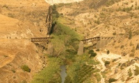 An Ottoman era bridge, once used for the Hijaz railway across the Yarmouk River on the border of Southern Syria and Northern Jordan, lies in disrepair since it was bombed by British forces in 1946.