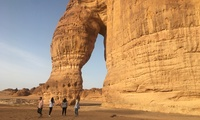 HKS students admire Elephant Rock in the desert near Al Ula, Saudi Arabia