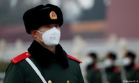 A masked officer in Beijing