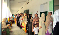 Women in Pakistan wait to vote.