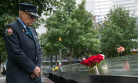 Retired New York City firefighter Joseph McCormick visits the South Pool prior to the September 11 memorial ceremony at the World Trade Center site in New York.