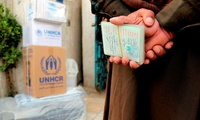 A displaced Iraqi man, who fled his town after the advance of Islamic militants in western Iraq, holds his family member's documents to present to staff of the United Nations refugee agency, UNHCR, distribution center, in an attempt to receive humanitarian assistance from them, in the Mansour district of Baghdad, Iraq, Tuesday, Feb. 24, 2015.