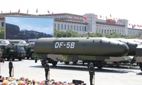 Military vehicles carry DF-5B intercontinental ballistic missiles during a parade commemorating the 70th anniversary of Japan's surrender during World War II held in front of Tiananmen Gate in Beijing, Sept. 3, 2015.