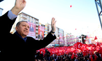 Turkey's president Recep Tayyip Erdogan waves to the crowd during his first official campaign in Kahramanmaras, southeastern Turkey, Friday, Feb. 17, 2017, ahead of the April 16 national referendum on expanding the president's powers.