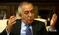 Palestinian Prime Minister Salam Fayyad speaks during an interview with the Associated Press in the West Bank city of Ramallah, Thursday, Dec. 1, 2011.