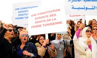 Tunisian women demonstrate for their rights during a protest in Tunis, Wednesday, Nov. 2, 2011.