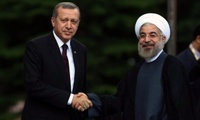 Turkey's Prime Minister Recep Tayyip Erdogan, left, and Iranian Presdent Hassan Rouhani pose for cameras before a meeting in Ankara, Turkey.