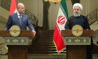 President Hassan Rouhani, right, speaks in a joint press briefing with his Iraqi counterpart Barham Salih after their meeting at the Saadabad Palace in Tehran, Iran, Saturday, Nov. 17, 2018
