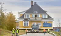 A Kiruna heritage building being moved intact in August 2017.