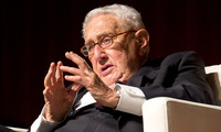 Kissinger speaks during a panel discussion.
