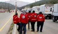 A convoy of vehicles loaded with food and other supplies organized by The International Committee of the Red Cross, working alongside the Syrian Arab Red Crescent and the U.N. makes it's way to the besieged town of Madaya, northwest of Damascus, Syria.