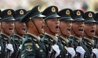 Members of China's People's Liberation Army (PLA) Rocket Force let out a yell as they march in formation during a parade to commemorate the 70th anniversary of the founding of Communist China in Beijing, Tuesday, Oct. 1, 2019. (AP Photo/Mark Schiefelbein)
