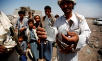 A man shows fragments of a bomb from the rubble of houses destroyed by a Saudi-led airstrike on the outskirts of Sanaa, Yemen, Wednesday, June 3, 2015.