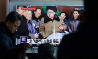 "People watch a TV news program showing North Korean leader Kim Jong Un with superimposed letters that read: ""North Korea has made nuclear warheads small enough to fit on ballistic missiles"" at Seoul Railway Station in Seoul, South Korea, Wednesday, March 9, 2016."
