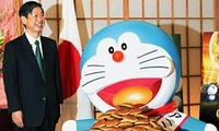 Japan's popular comic book character, Doraemon, is presented with dorayaki by Japanese Foreign Minister Masahiko Komura after Komura named Doraemon Japan's first Anime Ambassador on March 19, 2008. Doraemon will promote Japan's pop culture to the world.